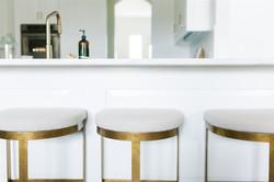 Kitchen design featuring brass lighting,