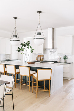 Open concept Kitchen design with glass pendants, quartzite countertops, waterfall island,