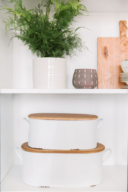 Shelf styling a cabinet by Laura Design