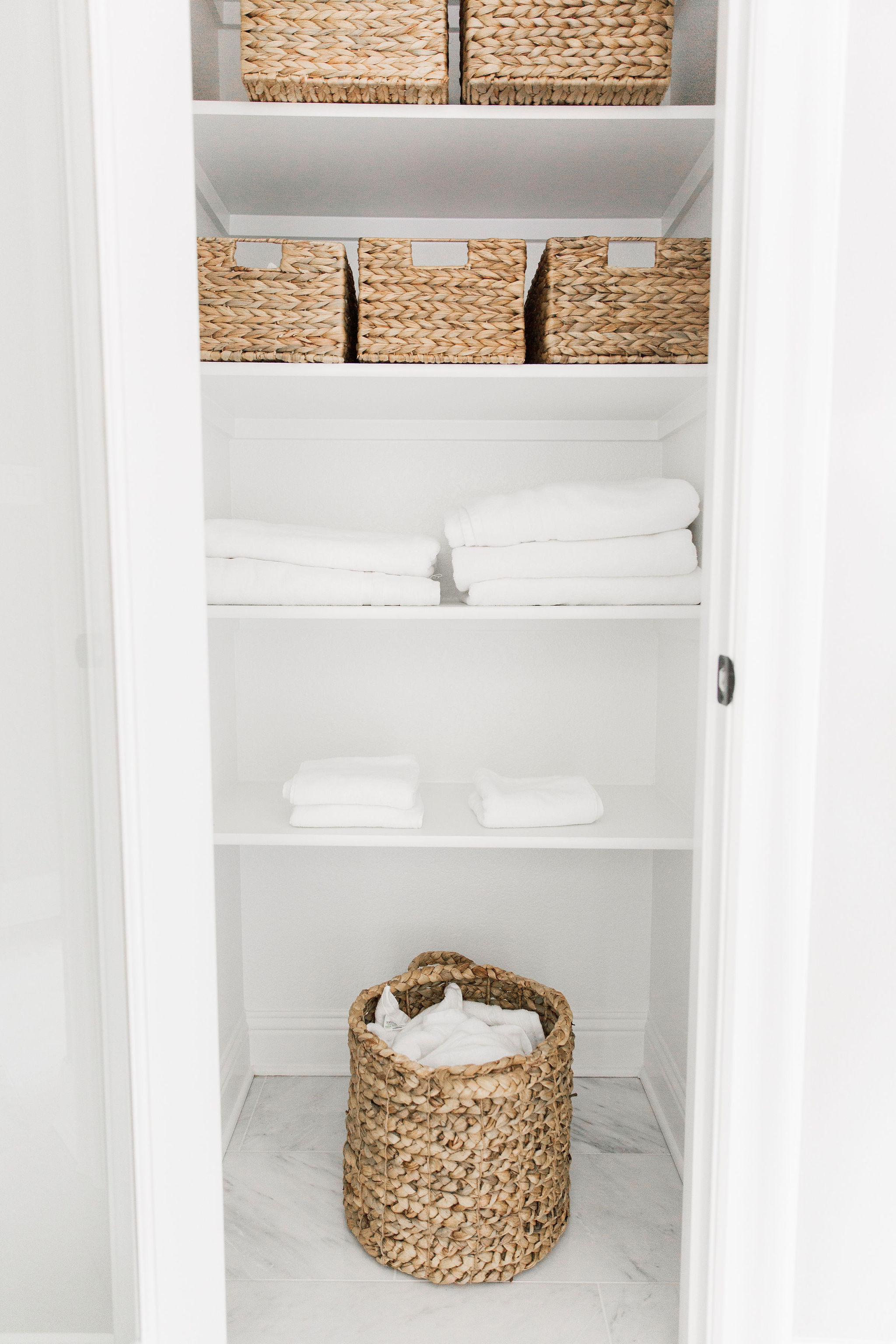 Bathroom styling with baskets and white