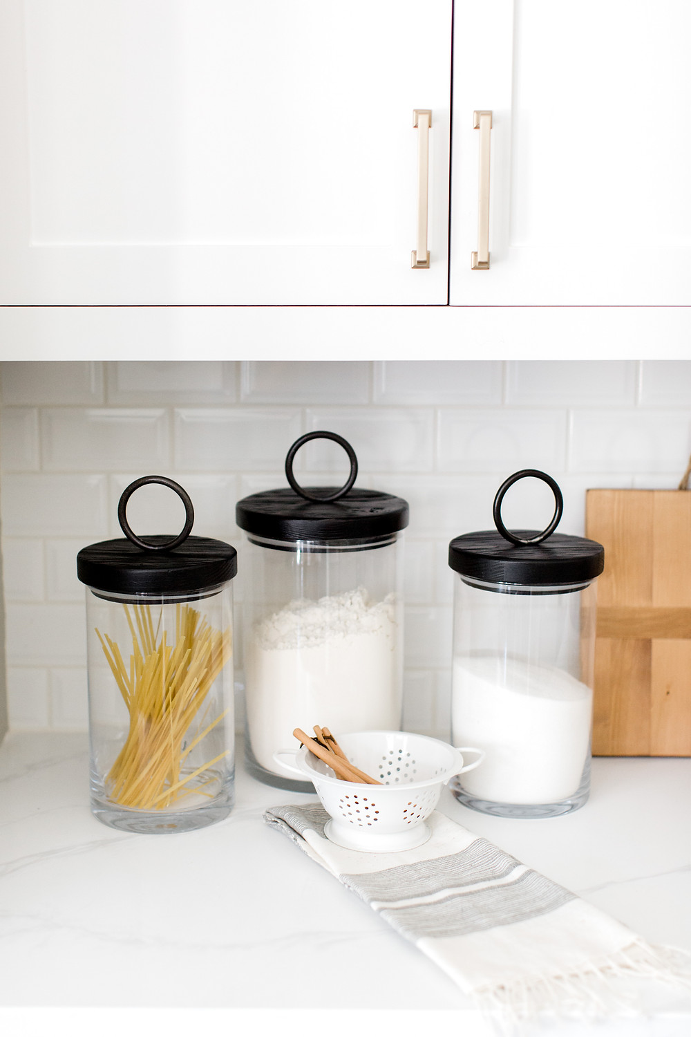 Metal lidded canister, kitchen design by Laura Design and Co, Dallas interior designer