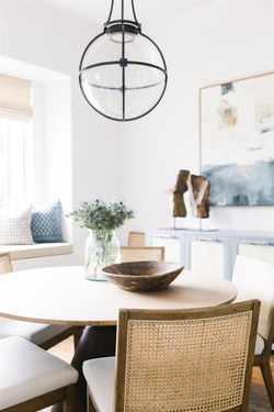 Breakfast nook design featuring white oa