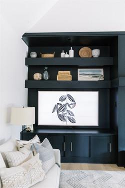 Dark built-ins, white sofa, and chevron rug by Laura Design and Co, Dallas interior design