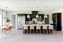 Kitchen design with brass & white pendan