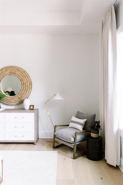 Linen drapes, accent chair, brass lamp and white dresser by Laura Design and Co, Dallas in