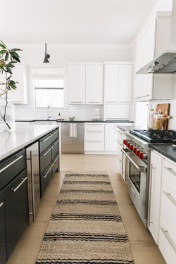 White oak floors, striped runner, Black soapstone countertops, white subway tile, white ca