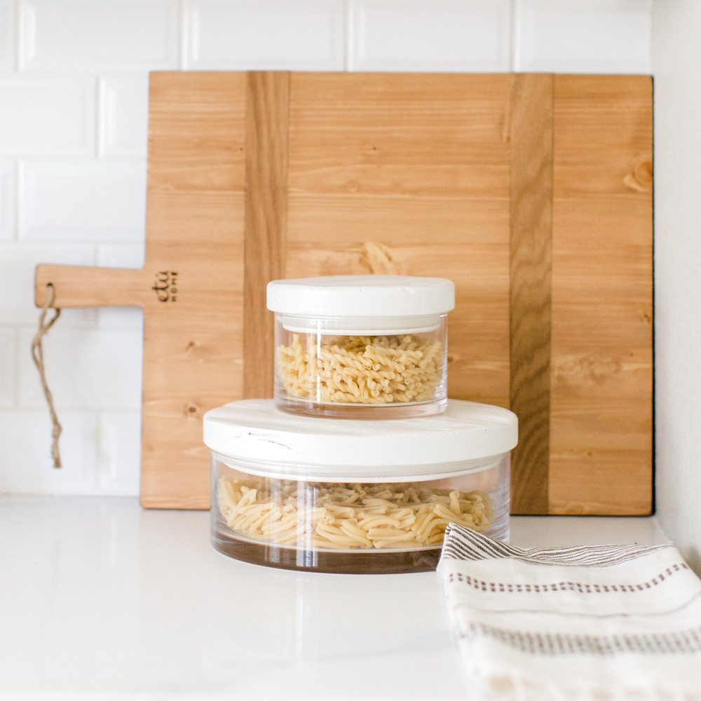 White wood lidded canisters, kitchen design by Laura Design and Co, Dallas interior designer