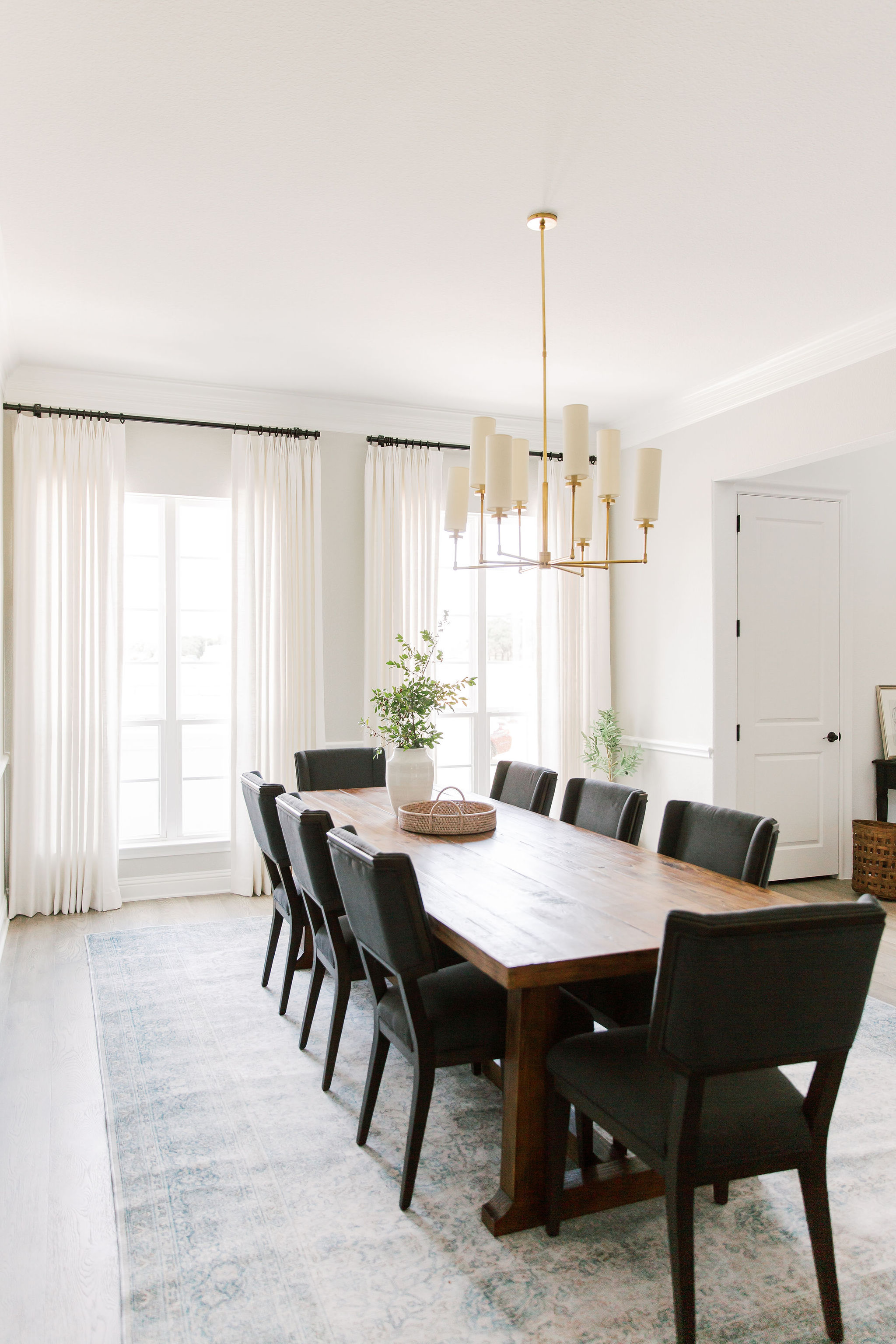 Dining room design with white linen drap
