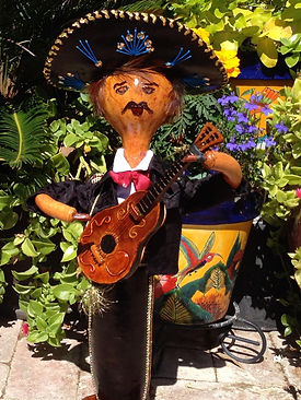 Beautiful Mariachi Gourd Figure with handmade Guitar and Sombrero made from gourd shards.