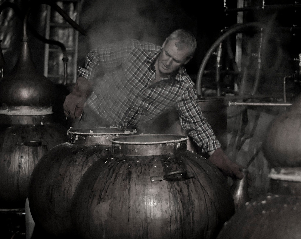Dr John distilling at our 200 litre copper pot stills
