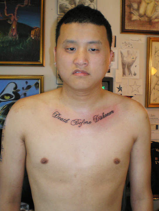 Man and collarbone tattoo.