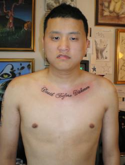 Man and collarbone tattoo.