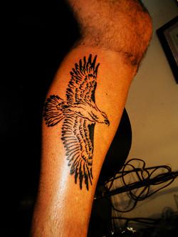 Big Tribal Eagle on calf.