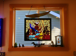 Stained Glass hangs in shop.