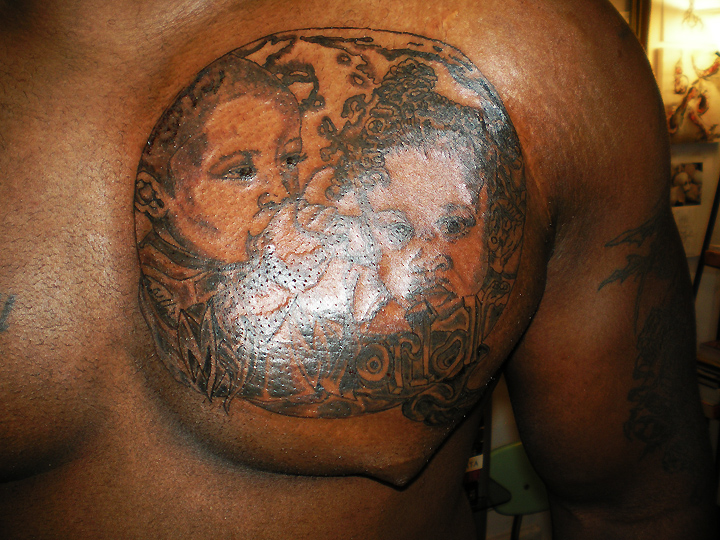 Ray's tattoo of twins close up.