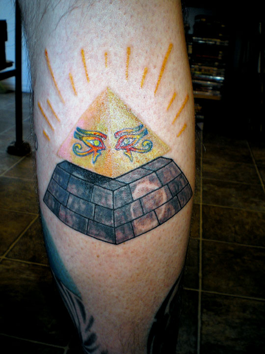 Magical Calf Pyramid Tattoo.
