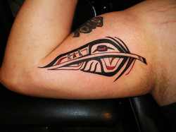 Feather Northwest styled tattoo.