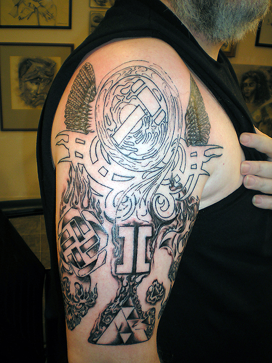 Total side view of complex tattoo.