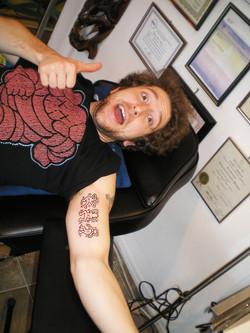 Keith Herring inner arm tattoo.