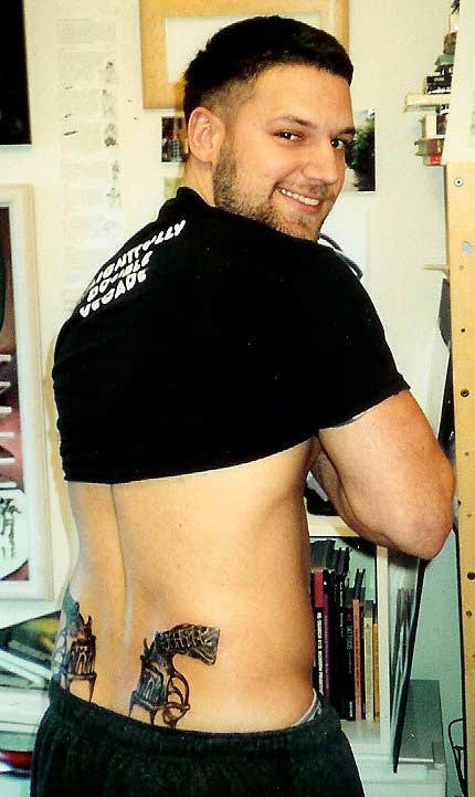 Back Pistols tattoo.