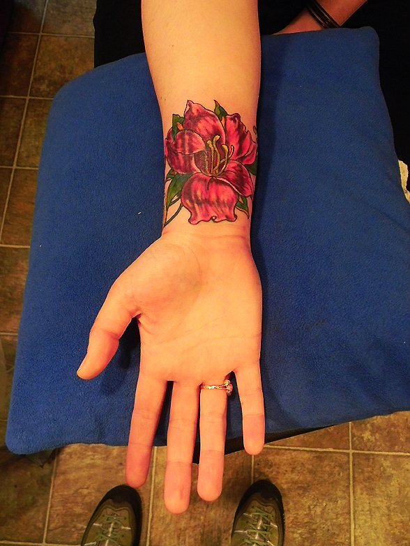 Flower over Royal Flush tattoo.