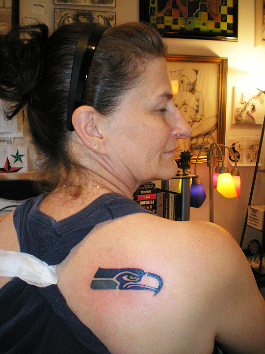 Woman and new Seahawk tattoo.