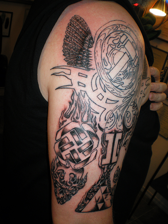 Tricep side of complex tattoo.