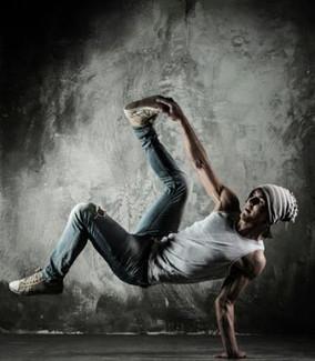 194871-371x425-man-doing-brake-dancing-m