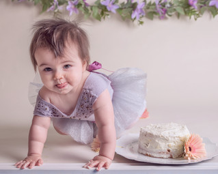little one loving her first take of cake!