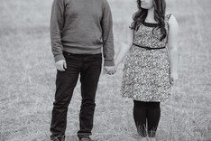 a young couple posing for engagement photos on the prairies