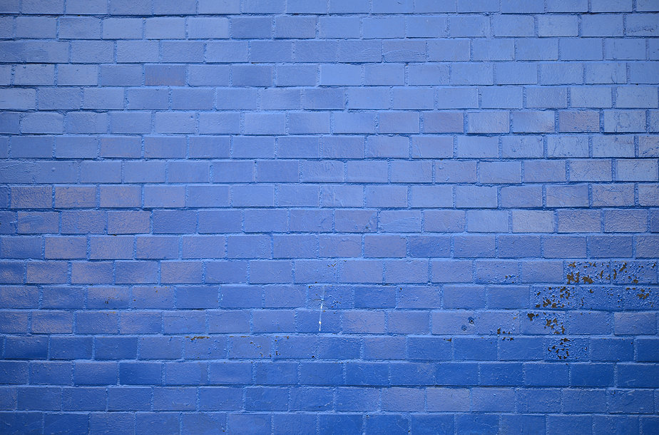 Background. Brick wall painted with blue