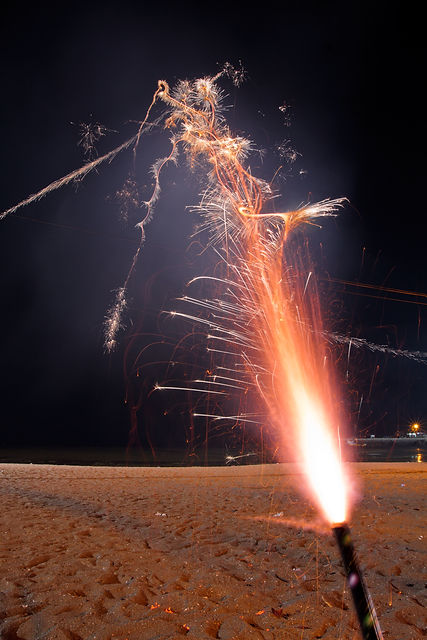 Shooting roman candle fireworks with lon