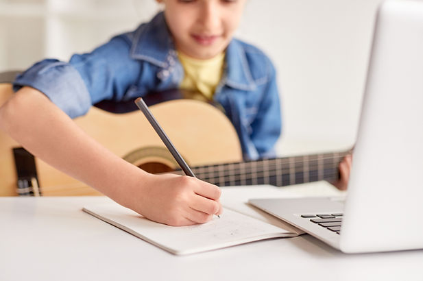A student writing down music notes