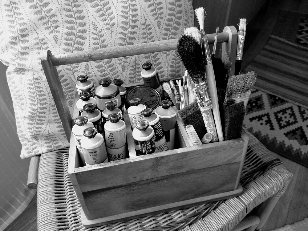 A box containing unused artist's paints