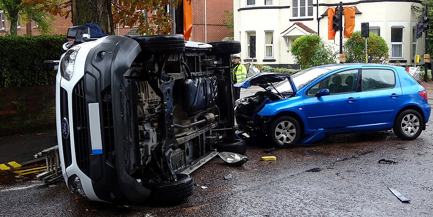 blue-car-and-white-van-crash.jpg