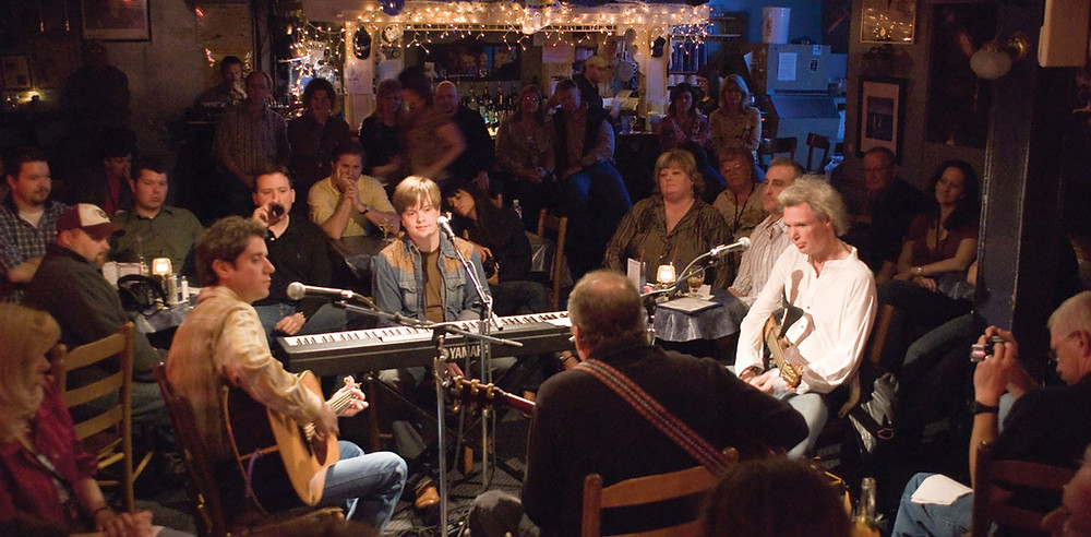 Writer's Round at the Bluebird Cafe in Nashville. That's me on piano, Harley Allen on my left, Kent Blazy facing me, and Kevin Denney on my right.