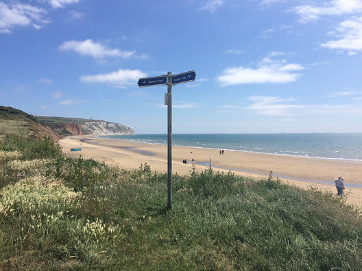 coast path sign and beach.JPG