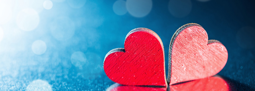 Two-red-love-hearts-blue-background-back