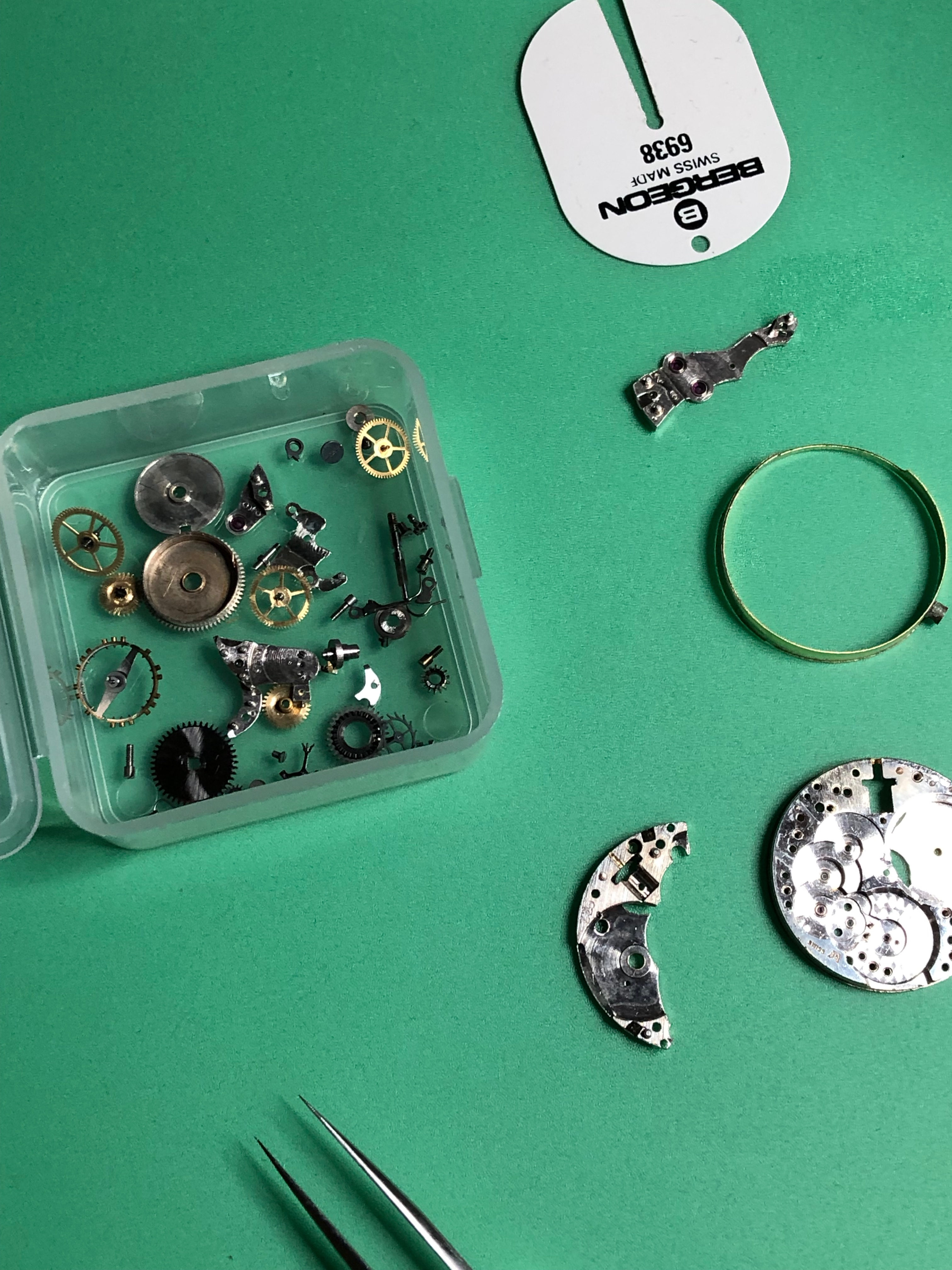A watch movement being stripped