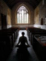 Tom Cowan meditating in a church.jpg
