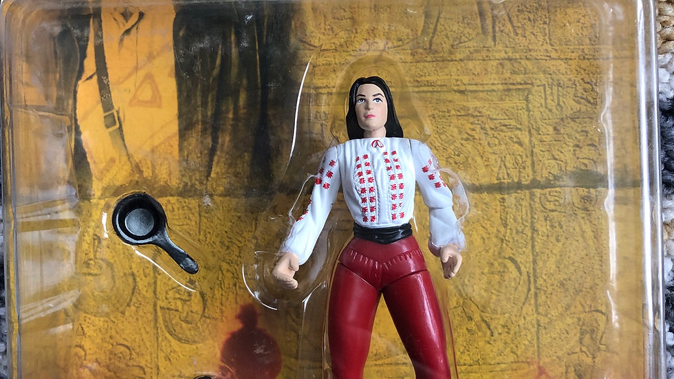 Indiana Jones Marion Ravenwood action figure with frying pan and monkey