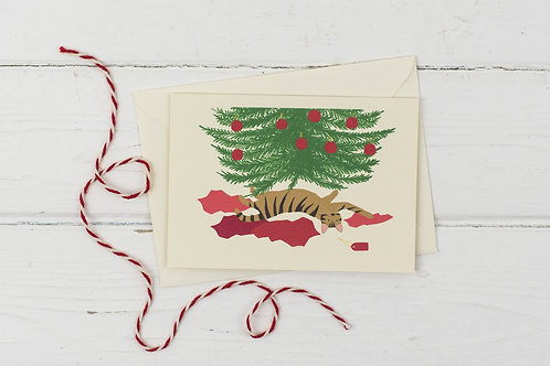 Naughty tabby cat under the Christmas tree- Christmas greetings card