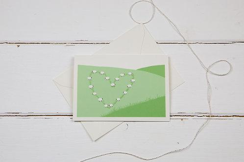 Sheep on the hillside love greetings card