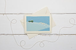 Landrover defender and sheep in the snow Christmas card