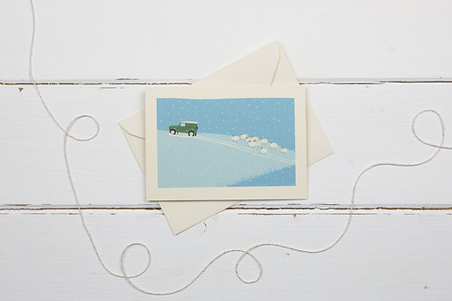 Landrover and flock of sheep- Country 4x4 in green out in the snow- card