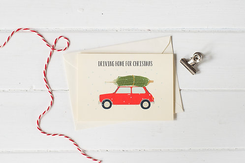Classic Mini Cooper in red with Christmas tree- greetings card