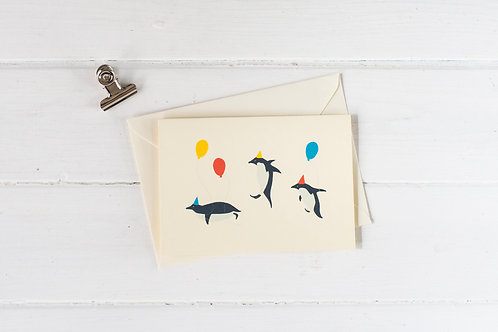 Penguin birthday party greetings card
