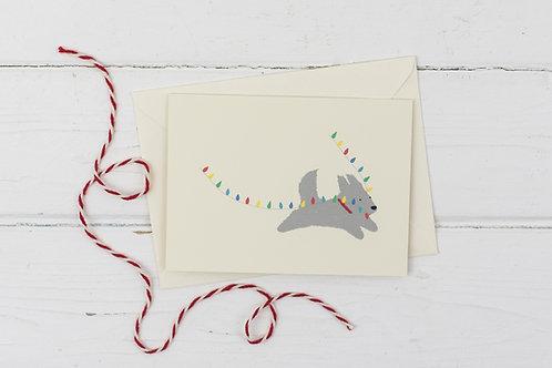 Naughty grey dog with fairy lights- Christmas card
