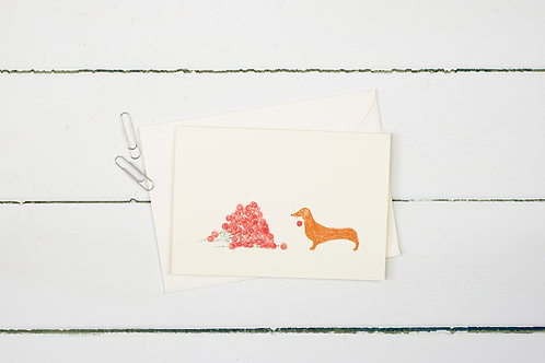 Sausage dog with roses greetings card