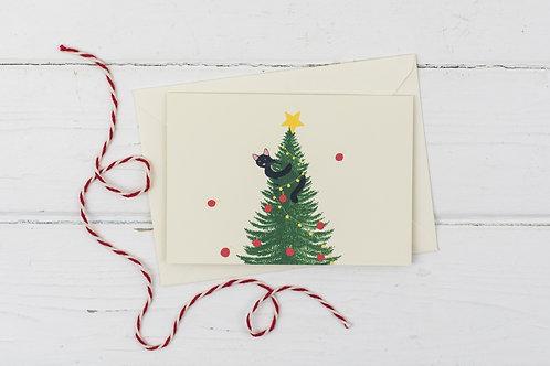 Naughty black cat up the Christmas tree- Christmas greetings card